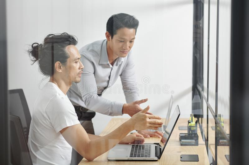 Project managers discussing work stock images