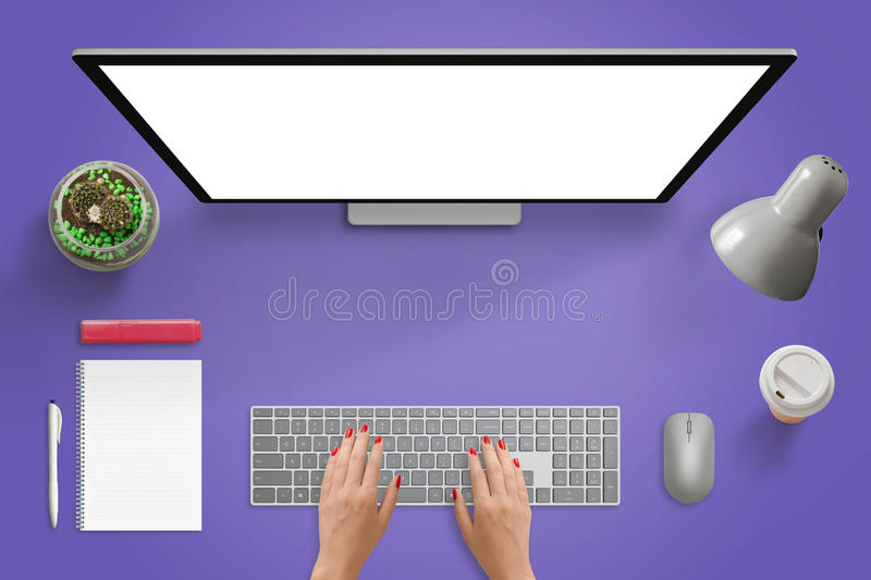 Creative purple desk scene. Designer studio with isolated screen for mockup. Woman typing on keyboard. Mouse, lamp, coffee, pad, pencil, marker, plant beside royalty free stock photo