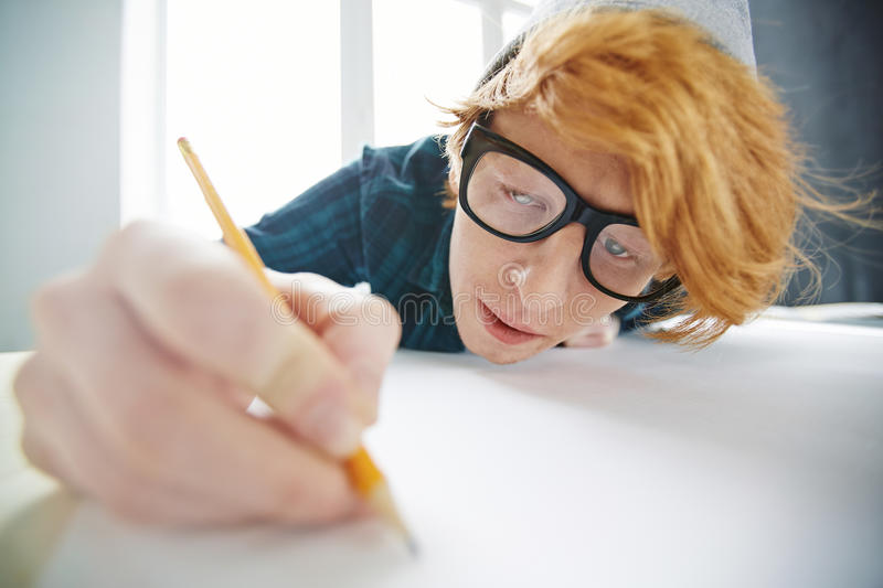 Creative Red haired Man Busy Drawing stock image