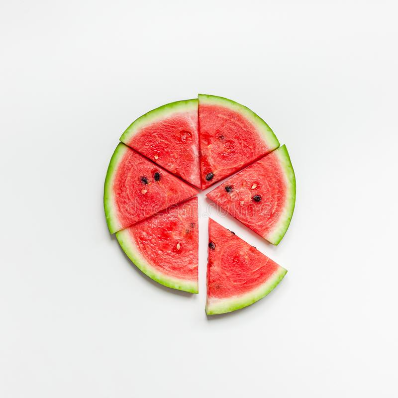 Fresh watermelon slices on white background. Creative scandinavian style flat lay top view of fresh watermelon slices on white table background copy space royalty free stock photography