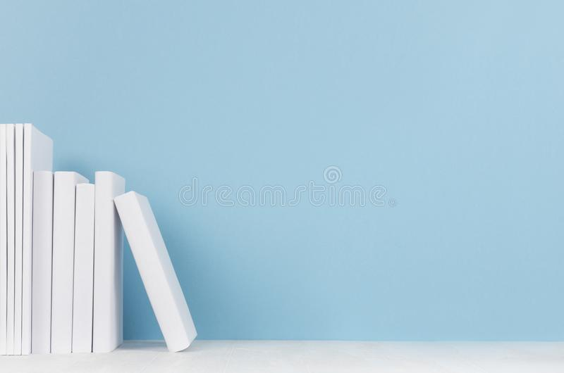 Creative school library - row white blank books on blue background. Back to school background with copy space. stock image