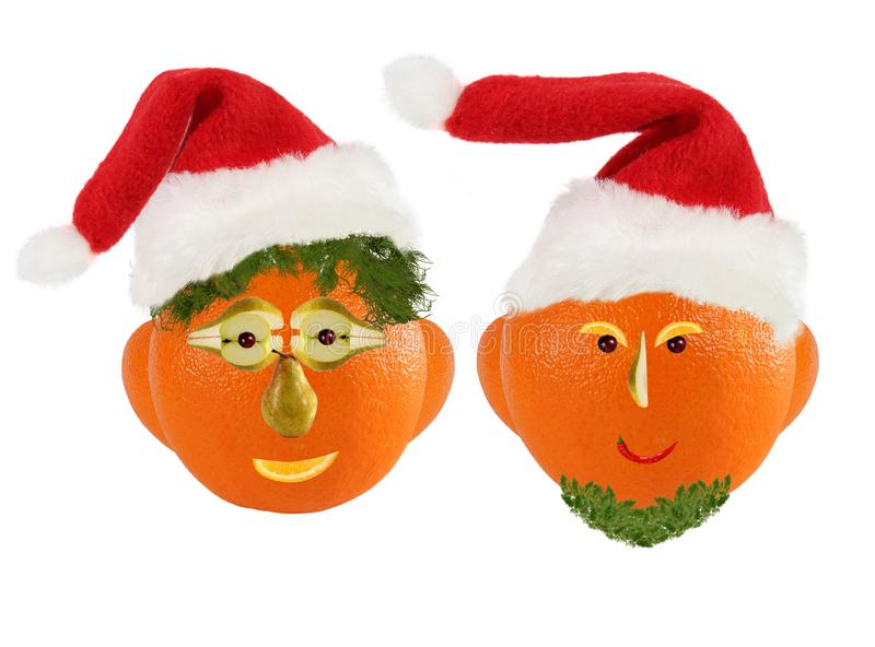 Creative set of food concept. Few  funny portraits of a Santa Clauses from vegetables and fruits royalty free stock image