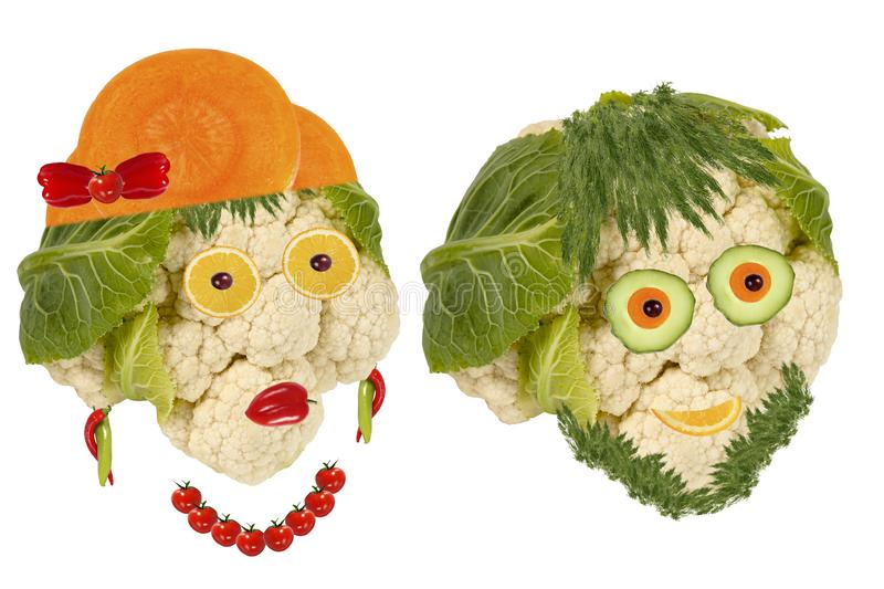 Creative set of food concept. Two  funny portraits from vegetables and fruits stock images