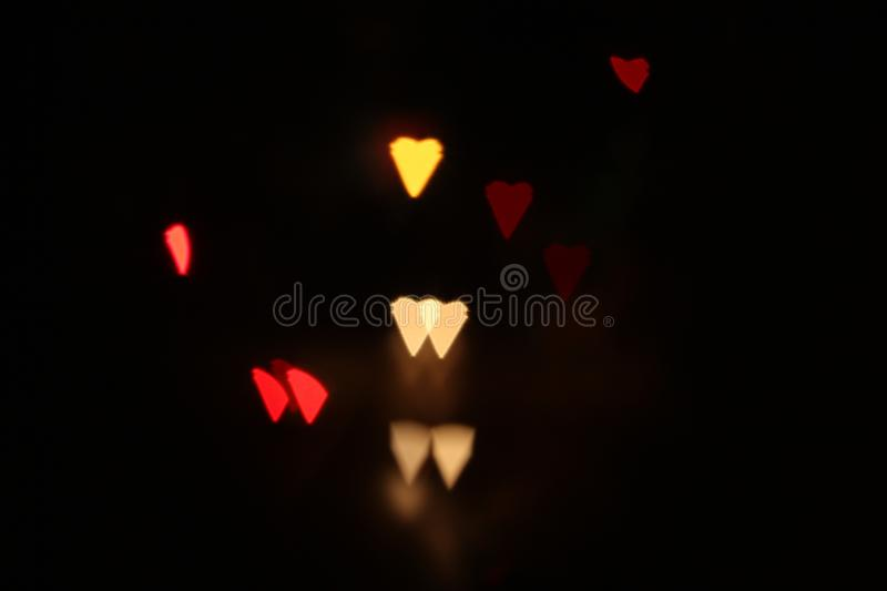 Creative shot. Which shows heart symbol basted on the outdoor lighting stock images