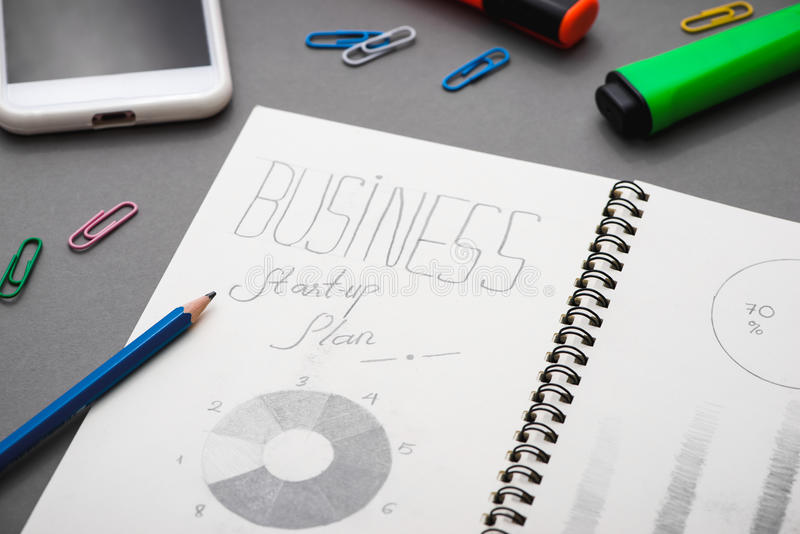 Creative sketch in spiral notepad with laptop on desk. Business. Starup plan stock photography