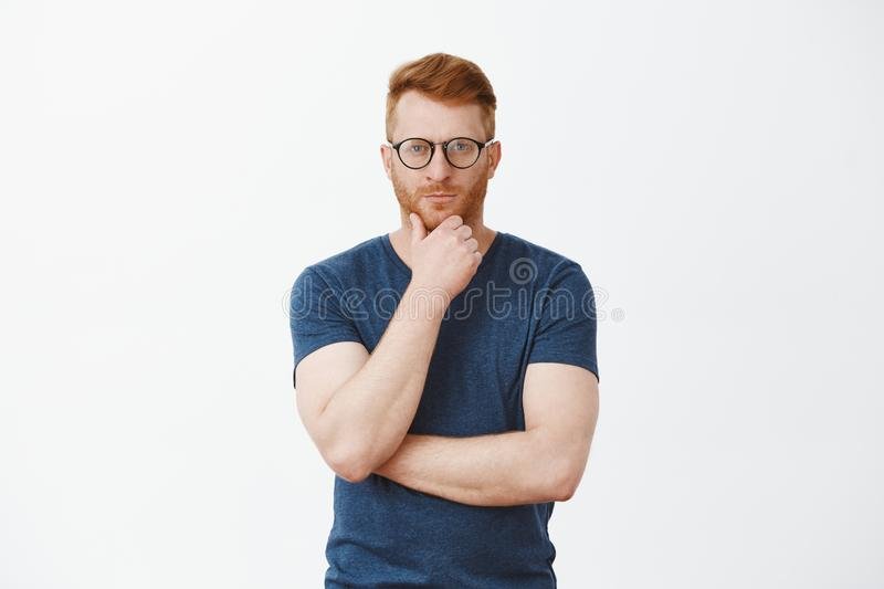 Creative and smart businessman thinking about new concept for business. Portrait of handsome strategist with red hair stock images