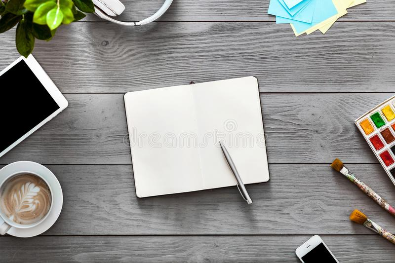 Creative student designer work table notebook devices on grey wood background stock photo