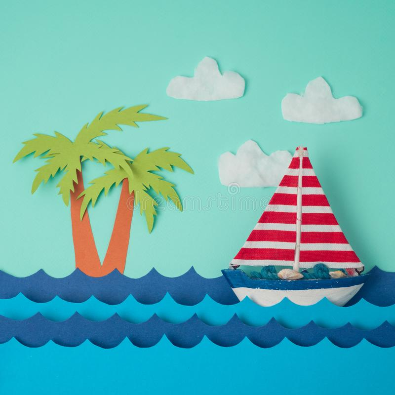 Creative summer background. With boat and paper sea. Flat lay minimal layout stock photo