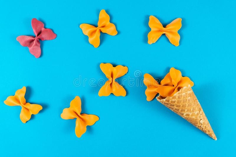 Creative summer layout made of ice cream cone, waffle cones and colored pasta semolina royalty free stock photos