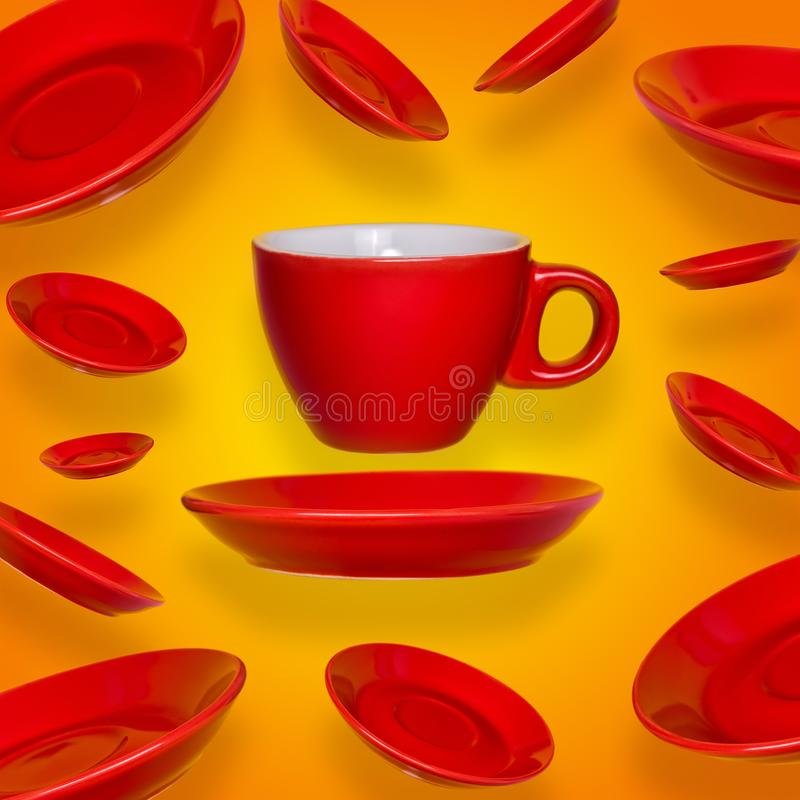 Creative surreal design with a red coffee cup and saucer on a yellow background stock photo