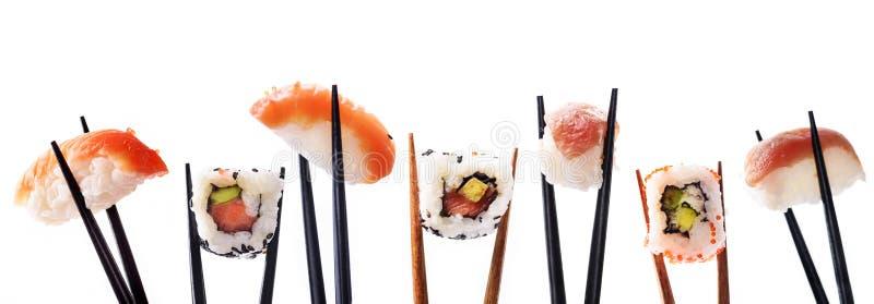 Creative sushi rolls on bamboo chopstick isolated on white background. Japanese luxury cuisine menu. Asian restaurant menu design. Mix of sushi pieces with stock image