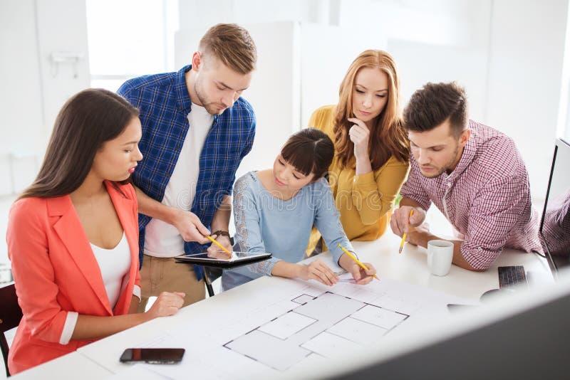 Creative team with blueprint working at office stock photo image download creative team with blueprint working at office stock photo image of brainstorm businessman malvernweather Gallery