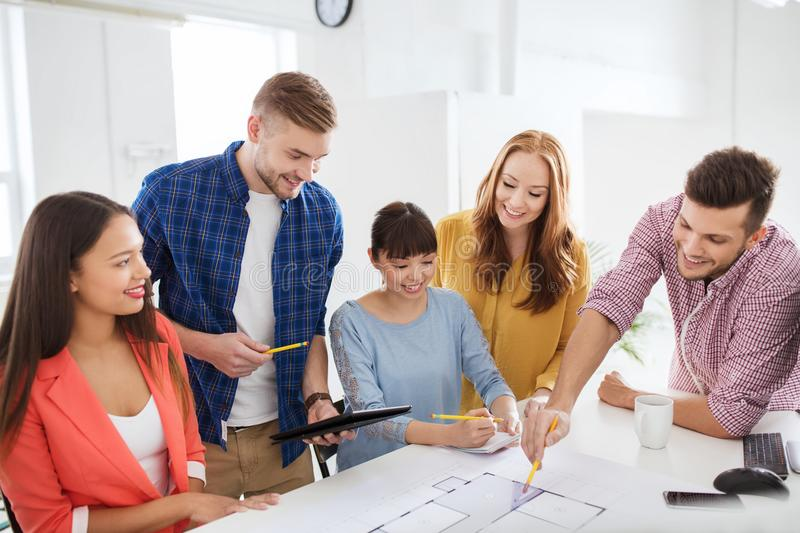 Creative team with blueprint working at office stock image image download creative team with blueprint working at office stock image image of businessman architecture malvernweather Gallery