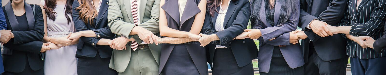 Creative team putting their hands together, business people teamwork banner concept. stock images