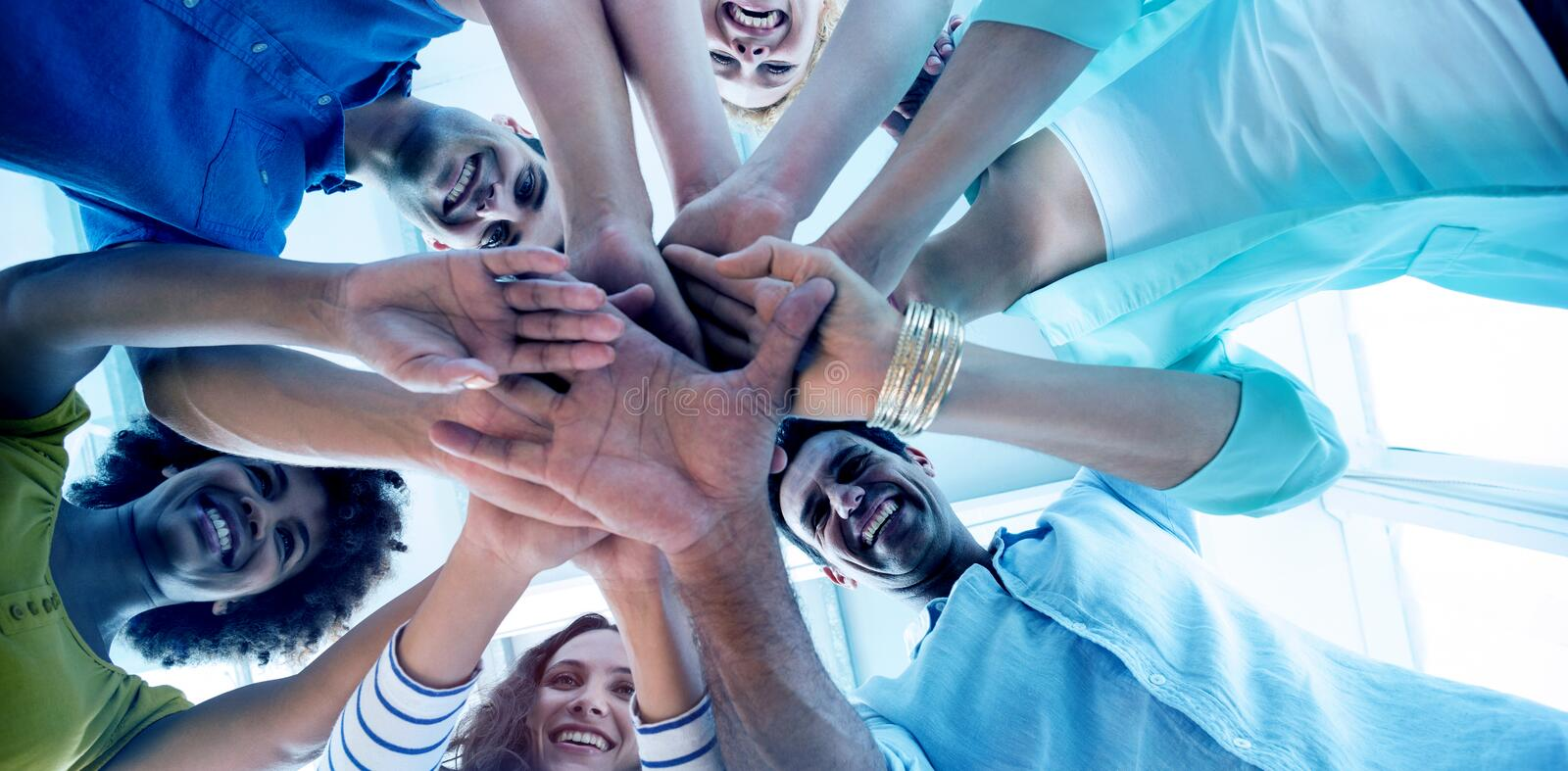 Creative team putting their hands together. In circle stock illustration
