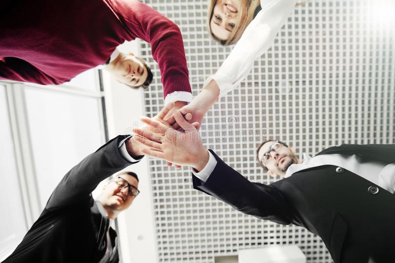 Creative team putting their hands together in circle. Team work. stock photo