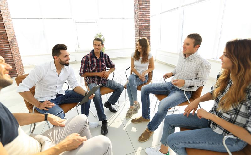 Team sitting in a lesson on team building royalty free stock photography