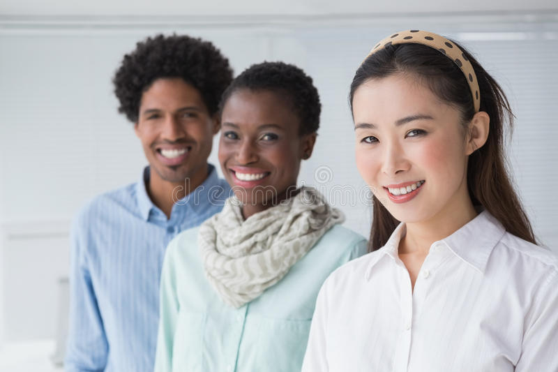 Creative team smiling together stock photo