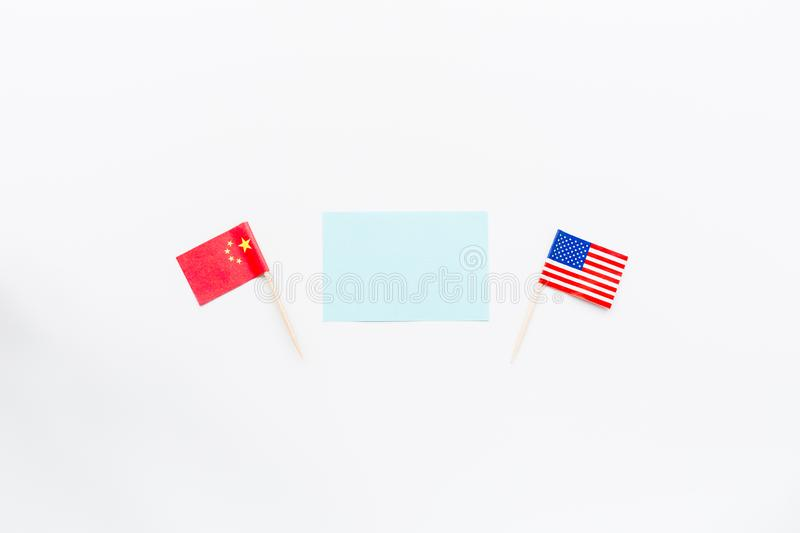 Creative top view flat lay of China and USA flag, mockup and copy space on white background in minimal style. Concept of royalty free stock photography