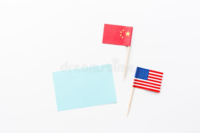 Creative top view flat lay of China and USA flag, mockup and copy space on white background in minimal style. Concept of stock photography