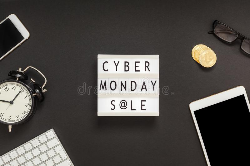 Creative Top view flat lay promotion composition Cyber Monday sale text on lightbox alarm clock white background copy space. Template Cyber Monday sale mockup royalty free stock photography