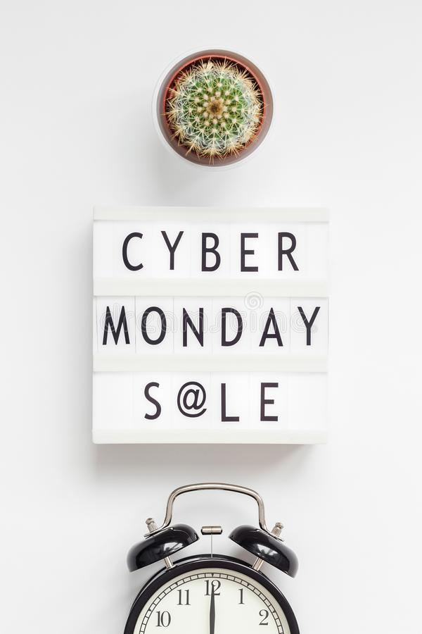 Creative Top view flat lay promotion composition Cyber Monday sale text on lightbox alarm clock white background copy space. Template Cyber Monday sale mockup stock photos