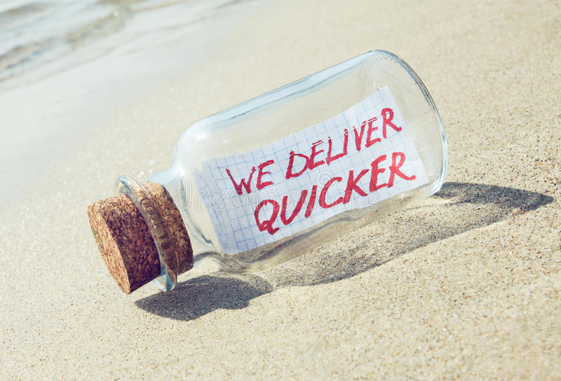 Creative transportation and goods delivery concept. Message in a bottle. Creative transportation concept. Message in a bottle with text royalty free stock photo