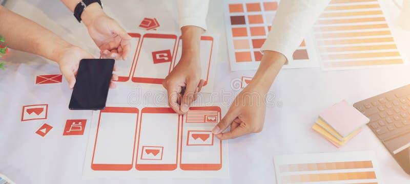 Creative ux designer hands designing screens for mobile responsive website development with UI/UX stock photos