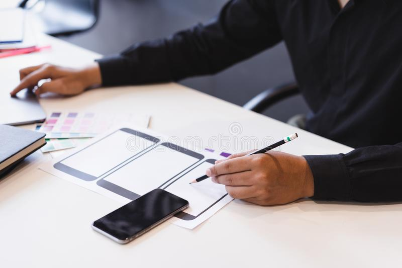 Creative ux designer hands sketching of screens for mobile responsive website development with UI/UX. App, interface, flat, navigation, button, internet, user stock photography