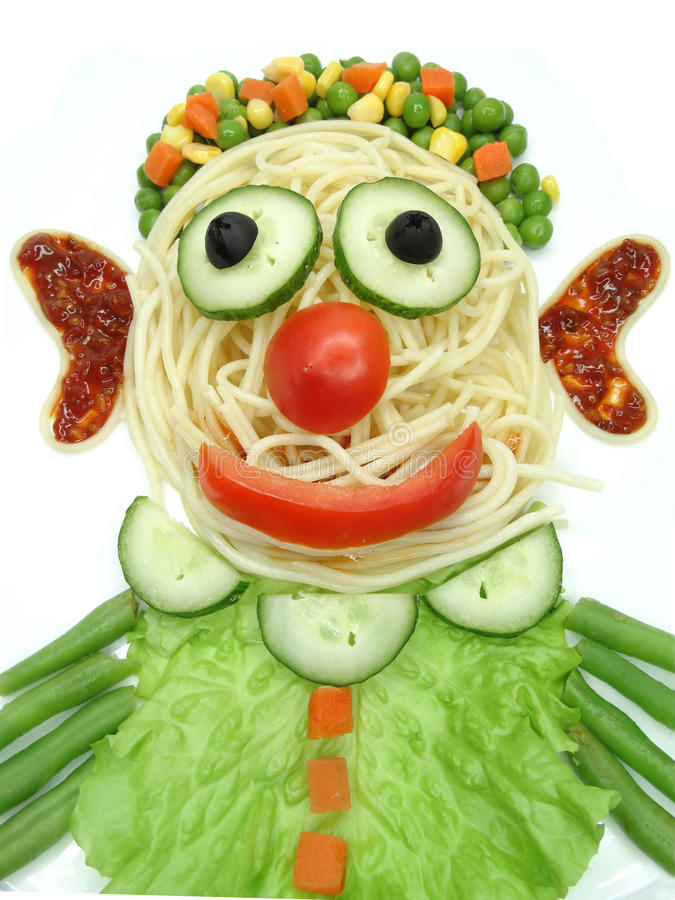 Creative vegetable food dinner clown form. Creative vegetable food meal with spaghetti clown form stock images