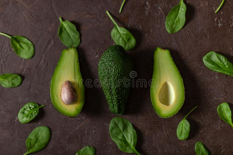 Creative vegetable pattern. Avocado and spinach royalty free stock image
