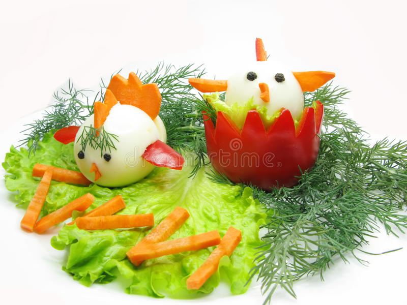 Creative vegetable salad with eggs. Creative vegetable salad made of eggs stock photo
