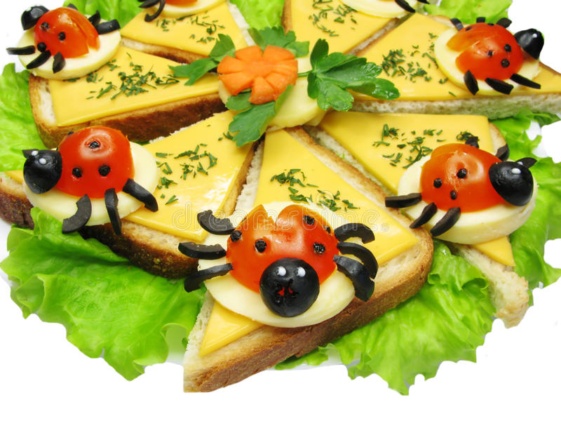 Creative vegetable sandwich with cheese. Creative sandwich with cheese and lady bugs made of tomato stock photography