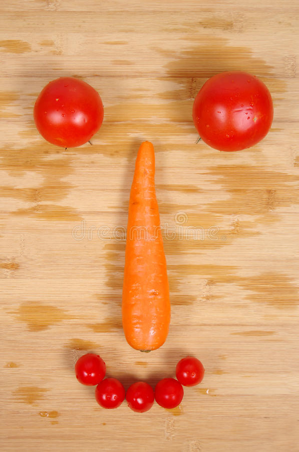 Creative vegetable smiling face royalty free stock images