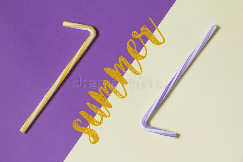 Creative view of drinking straws for party on a two-tone background - ultra violet and yellow. Complementary colors. Creative view of drinking straws for party stock photos