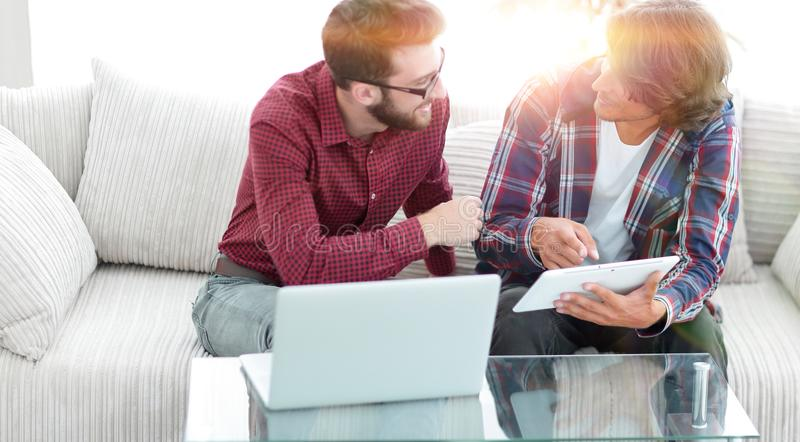 Creative web designers working with a tablet and a laptop. royalty free stock photography