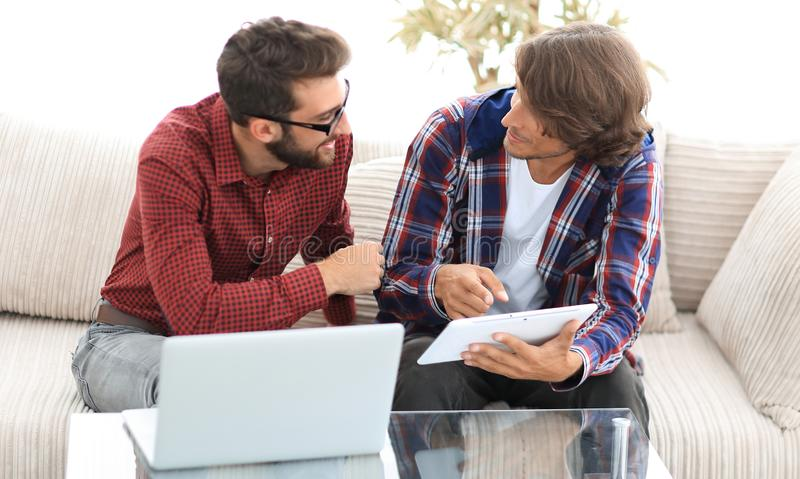 Creative web designers working with a tablet and a laptop. royalty free stock images