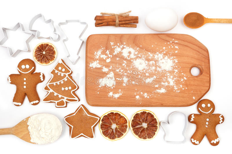 Creative winter time baking background. Kitchen utensils and ingredients for christmas homemade gingerbread cookies on white royalty free stock image