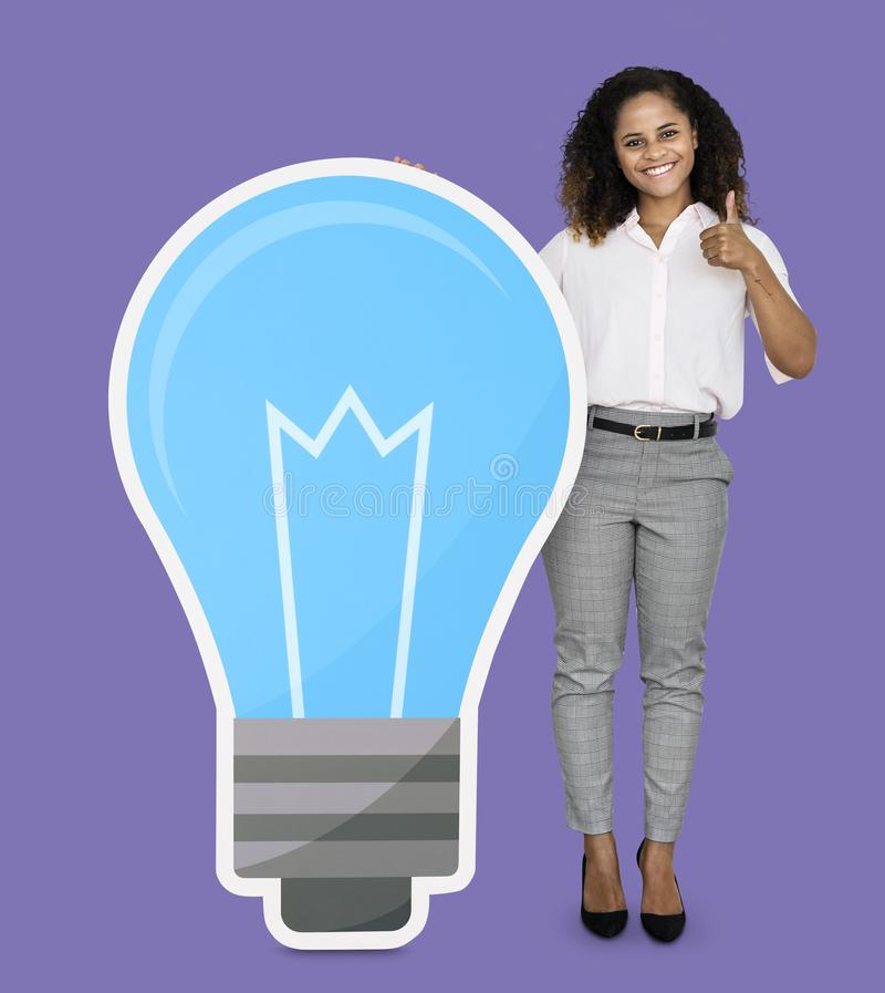 Creative woman with a blue light bulb symbol stock images