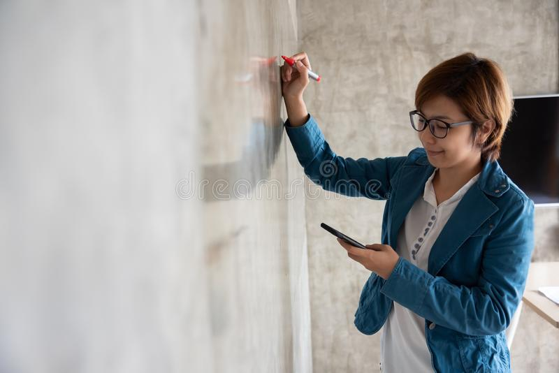 Creative woman drawing on the wall royalty free stock photography