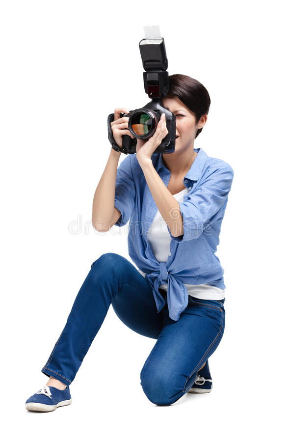 Creative woman-photographer takes images stock photo