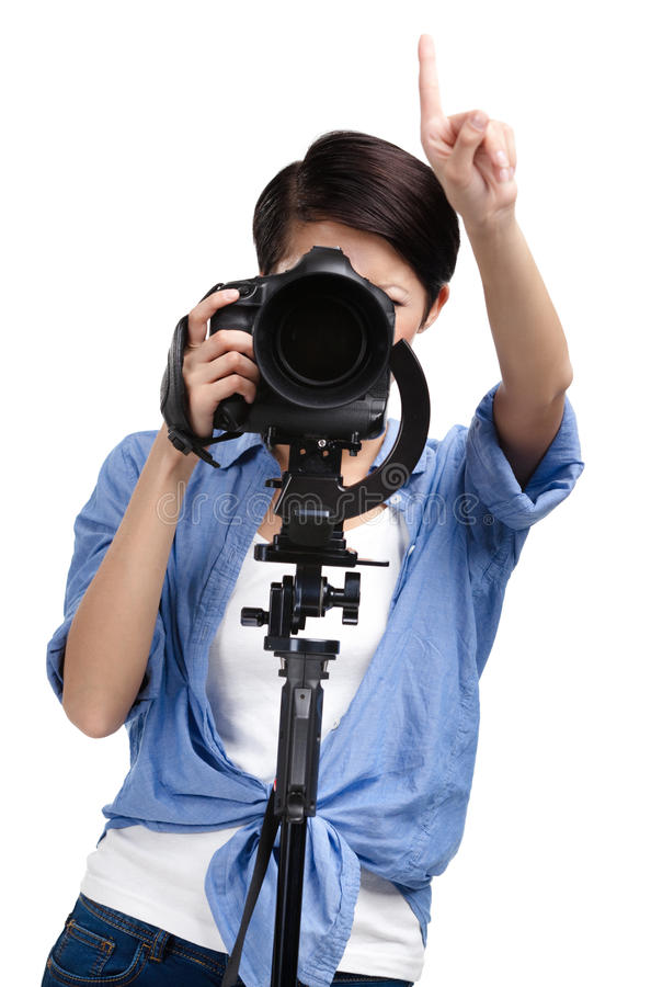 Creative woman-photographer takes pictures stock photo