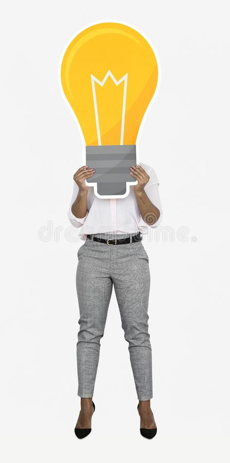 Creative woman showing a light bulb icon stock photos