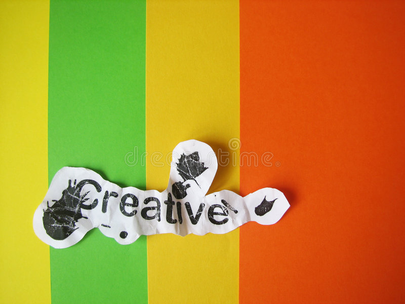 Creative word cut from paper. On striped colored background royalty free stock images