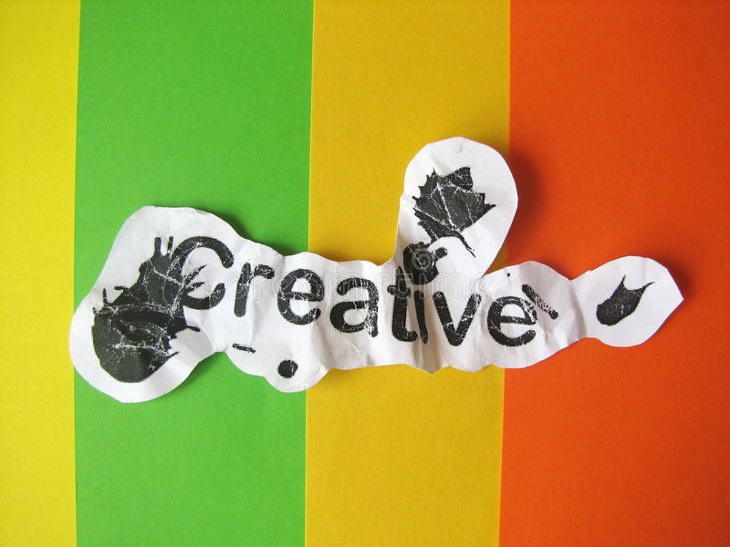 Creative word cut from paper. On striped colored background royalty free stock image