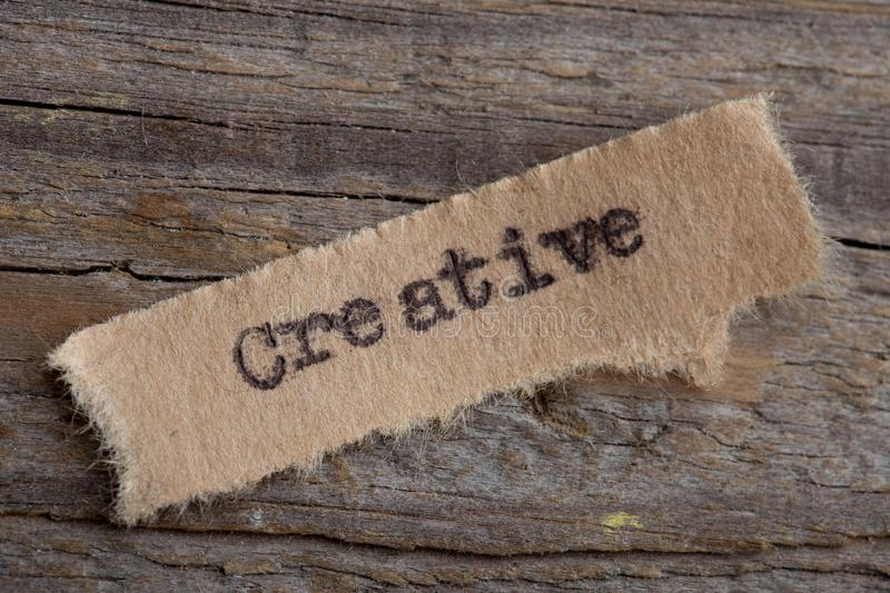Creative - word on a piece of paper close up, business creative motivation concept. Success, education, corporate, idea, typewriter, commerce, competence stock photography