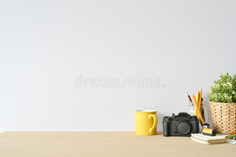 Creative workspace camera and office supplies on wood desk with copy space royalty free stock photography