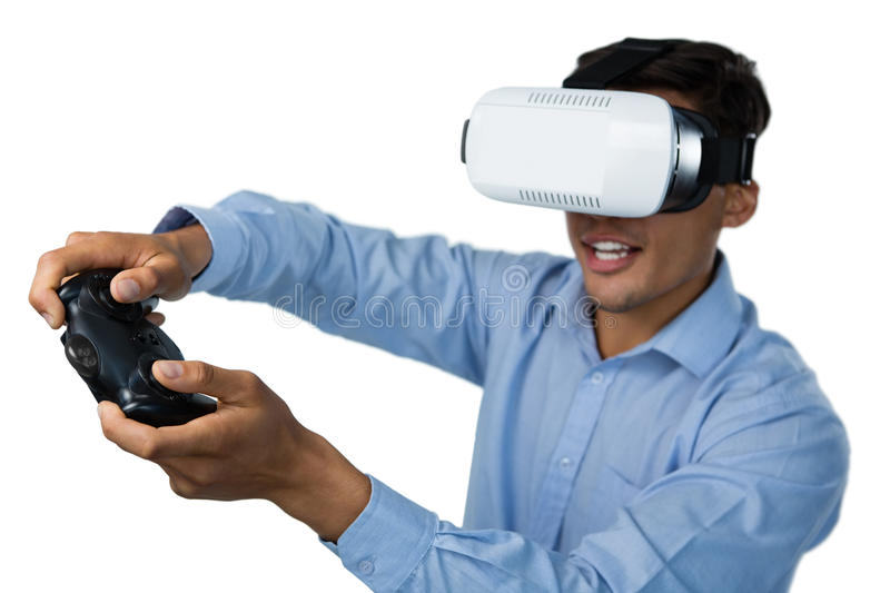 Creative young businessman wearing vr glasses while video game royalty free stock photography