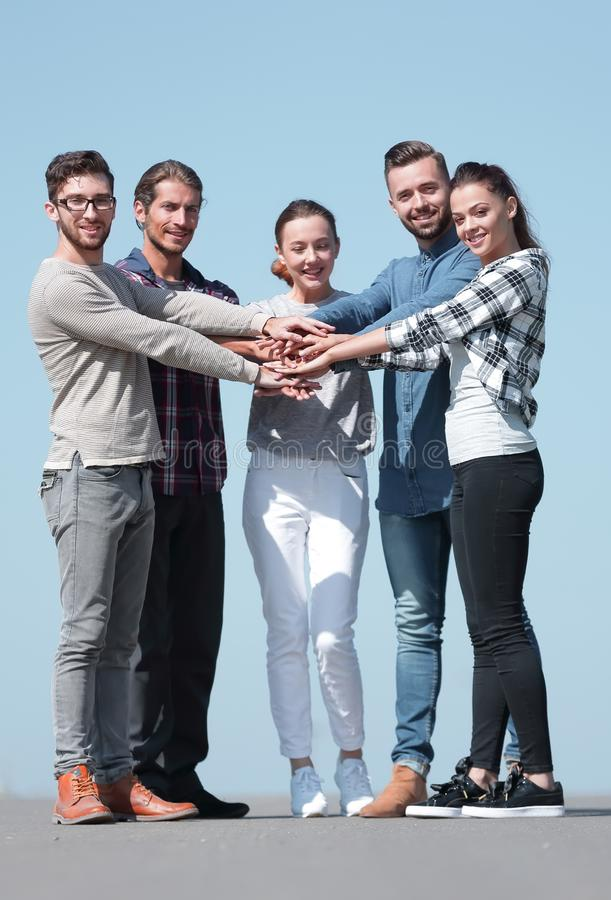 Creative young people is clasped their hands together. royalty free stock photo