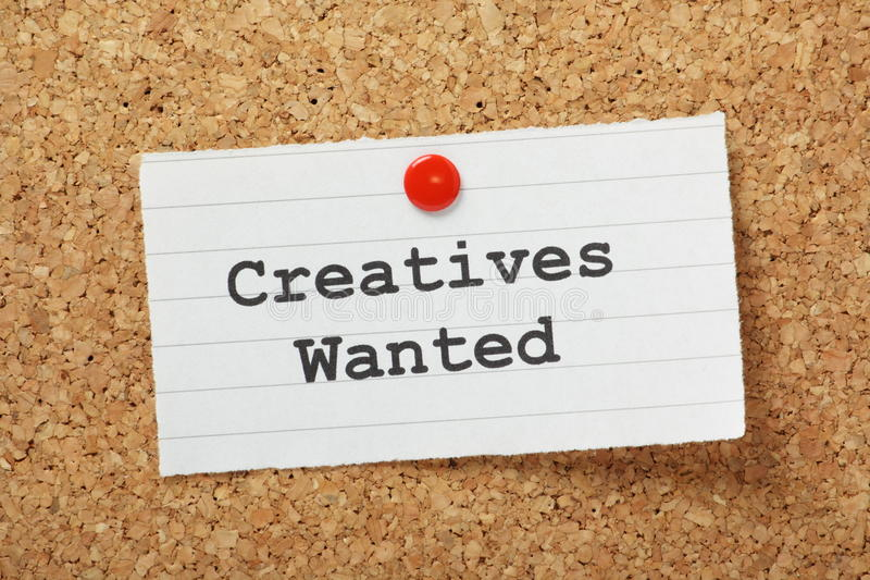 Creatives Wanted. The phrase Creatives Wanted typed on a paper note and pinned to a cork notice board stock images